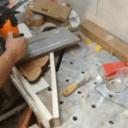 Planage d'une tranche de cade à la défonceuse