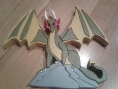 Dragon sur rocher création