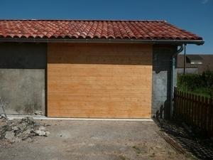 Porte de garage coulissante isolée